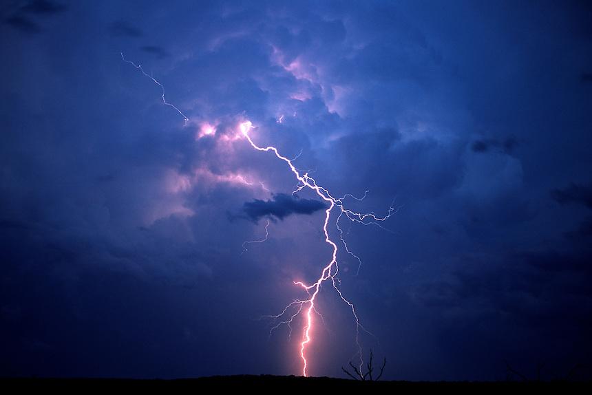 Cloud-to-ground lightning strikes outside of a cumulonimbus (thunderstorm) near Mertzon Texas in June.