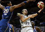 San Antonio's Becky Hammon (25) drives past Washington's Alana Beard (20) during the WNBA game between the San Antonio Silver Stars and the Washington Mystics, June 6, 2008, at the AT&T Center, San Antonio, Texas. San Antonio won 63 - 52. (Darren Abate/PressPhotoIntl.com)