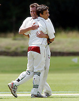 Alex Scrini of Hornsey is congratulated by Martin Tucker (L) after running out Evan Flowers of North Middlesex during the Middlesex County League Division two game between North Middlesex and Hornsey at Park Road, Crouch End on Sat July 9, 2011