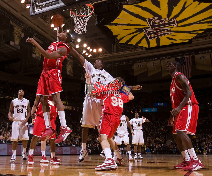 Eric Hall #33 of the Radford Highlanders grabs a rebound in front of Al-Farouq Aminu #1 of the Wake Forest Demon Deacons at the LJVM Coliseum December 30, 2008 in Winston-Salem, NC. (Photo by Brian Westerholt / Sports On Film)