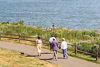 Walkers enjoying a stroll along the Lake Phalen Park shoreline. St Paul Minnesota USA
