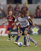 Real Salt Lake midfielder Kyle Beckerman (5) successfully tackles Toronto FC midfielder Dwayne De Rosario (14). Salt Lake Real defeated Toronto FC, 3-0, at Rio Tinto Stadium on June 27, 2009.