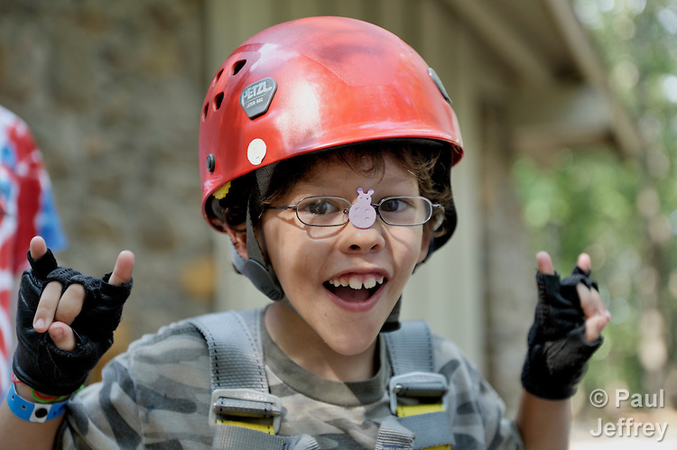 Gavin Carney prepares to ride a zip line at Camp Aldersgate in Little Rock, Arkansas. The camp, supported by United Methodist Women, offers children suffering from a variety of disabilities a safe and fun experience similar to that which normally-abled children often enjoy.