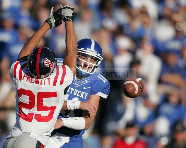 UK quarterback Maxwell Smith attempts to pass through Mississippi Rebels defensive back Cody Prewitt during the first half of the UK's home game against Ole Miss at Commonwealth in Lexington, Ky., Nov. 5, 2011. Photo by Brandon Goodwin | Staff