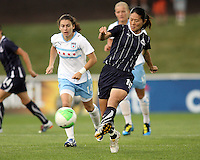 Homare Sawa #10 of the Washington Freedom sends off a pass in front of Karen Carney #14 of the Chicago Red Star during a WPS match at the Maryland Soccerplex, in Boyds Maryland on June 12 2010. The game ended in a 2-2 tie.