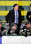 2 January 2011: Army Black Knights' Assistant Coach Trevor Large watches play from behind the bench during a game against the Ohio State University Buckeyes at Gutterson Fieldhouse in Burlington, Vermont. The Buckeyes defeated the Black Knights 5-3 to win the 2010-2011 Catamount Cup. Mandatory Credit: Ed Wolfstein Photo