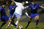 28 November 2015: North Carolina's Tucker Hume (36) is defended by Creighton's Eric DeJulio (22) and Lucas Stauffer (left). The University of North Carolina Tar Heels hosted the Creighton University Bluejays at Fetzer Field in Chapel Hill, NC in a 2015 NCAA Division I Men's Soccer Tournament Third Round match. Creighton won the game 1-0.
