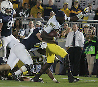 State College, PA - 10/12/2013:  Michigan QB Devin Gardner (98) has his helmet removed during a run.  Gardner was 15 for 28 for 240 yards and 3 touchdowns.  Penn State defeated Michigan by a score of 43-40 in 4 overtimes on Saturday, October 12, 2013, at Beaver Stadium.<br /> <br /> Photos by Joe Rokita / JoeRokita.com