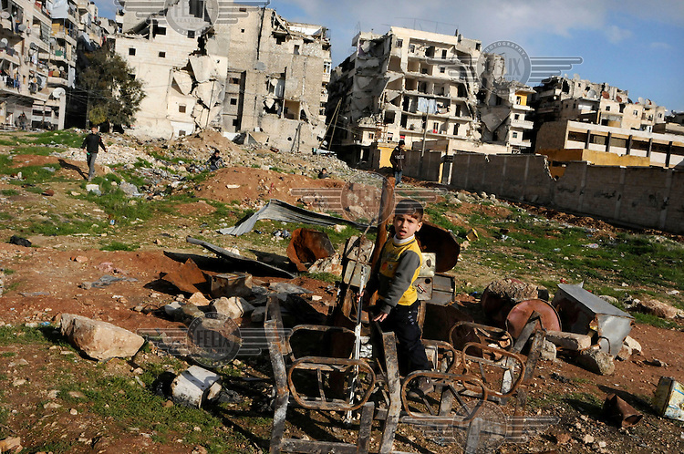 Children playing on waste ground in Hamdaniya a heavily battle-damaged suburb near the frontline on the city's outskirts.