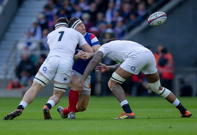 France's Guilhem Guirado is tackled by England's Tom Curry<br /> <br /> Photographer Bob Bradford/CameraSport<br /> <br /> Guinness Six Nations Championship - England v France - Sunday 10th February 2019 - Twickenham Stadium - London<br /> <br /> World Copyright &copy; 2019 CameraSport. All rights reserved. 43 Linden Ave. Countesthorpe. Leicester. England. LE8 5PG - Tel: +44 (0) 116 277 4147 - admin@camerasport.com - www.camerasport.com