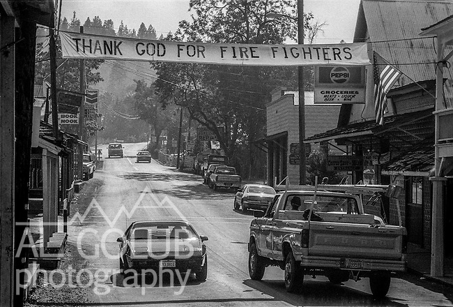 September 8, 1987 Yosemite National Park, California -- Stanislaus Complex Fire  -- Groveland residents hang a banner across the highway to express their thanks to firefighters leaving the Stanislaus National Forest.  The Stanislaus Complex Fire consumed 28 structures and 145,980 acres.  One US Forest Service firefighter, David Ross Erickson, died from a tree-felling accident.