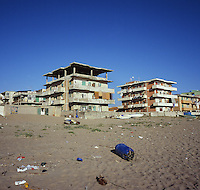 Run down apartments line the beach in Licola, Italy, Monday, July 7, 2010. Licola has at times been home to a booming tourist industry being in close proximity to archeological site. .PHOTOS/ MATT NAGER