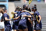 CHAPEL HILL, NC - MAY 20: Navy's Kelly Larkin (7) is mobbed by teammates after scoring a goal. The University of North Carolina Tar Heels hosted the U.S. Naval Academy Midshipmen on May 20, 2017, at Fetzer Field in Chapel Hill, NC in an NCAA Women's Lacrosse Tournament Quarterfinal match. Navy won the game 16-14.