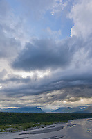 Weather drama over the chulitna river and Alaska Range mountains, viewed from the mt Denali overlook on the george parks highway, Alaska.