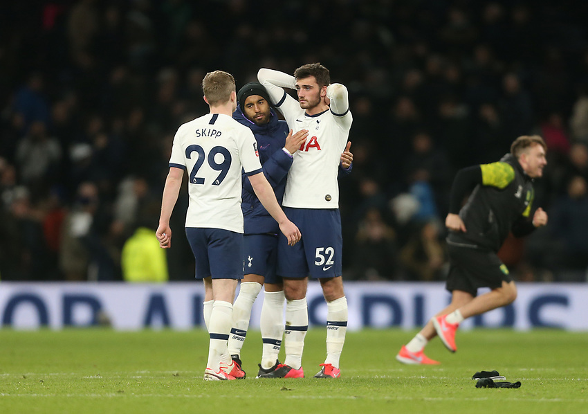 Tottenham Hotspur's Troy Parrott is consoled at the end of the game by Oliver Skipp and Lucas Moura<br /> <br /> Photographer Rob Newell/CameraSport<br /> <br /> The Emirates FA Cup Fifth Round - Tottenham Hotspur v Norwich City - Wednesday 4th March 2020 - Tottenham Hotspur Stadium - London<br />  <br /> World Copyright © 2020 CameraSport. All rights reserved. 43 Linden Ave. Countesthorpe. Leicester. England. LE8 5PG - Tel: +44 (0) 116 277 4147 - admin@camerasport.com - www.camerasport.com