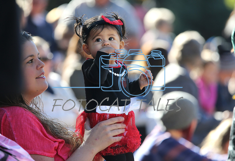 Carrie Quihuis and her daughter Sofia Romo-Quihuis, 10 months, watch the Nevada Day parade in Carson City, Nev., on Saturday, Oct. 31, 2015. <br /> Photo by Cathleen Allison