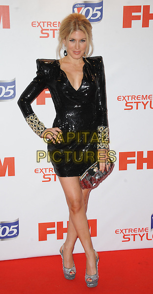 Hofit Golan.Arrivals at the FHM 100 Sexiest Women in the World 2012 Party held at the Proud Cabaret, London, England..May 1st, 2012.full length dress black shoulder pads gold cuffs clutch bag silver clutch bag hand on hip.CAP/WIZ.© Wizard/Capital Pictures.