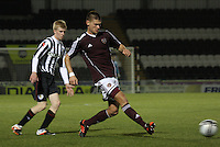 Dennis Prychenaco closed down by Jack Smith in the St Mirren v Heart of Midlothian Clydesdale Bank Scottish Premier League U20 match played at St Mirren Park, Paisley on 6.11.12.