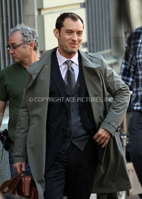WWW.ACEPIXS.COM . . . . .  ....April 19 2012, New York City....Actor Jude Law was on the Harlem set of the new movie 'The Bitter Pill' on April 19 2012 in New York City....Please byline: Zelig Shaul - ACE PICTURES.... *** ***..Ace Pictures, Inc:  ..Philip Vaughan (212) 243-8787 or (646) 769 0430..e-mail: info@acepixs.com..web: http://www.acepixs.com
