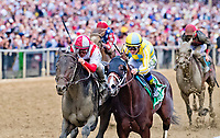 BALTIMORE, MD - MAY 20: Cloud Computing #2 (red cap), ridden by Javier Castellano, outduels Classic Empire #5, ridden Julien Leparoux, to win the Preakness Stakes on Preakness Stakes Day at Pimlico Race Course on May 20, 2017 in Baltimore, Maryland.(Photo by Scott Serio/Eclipse Sportswire/Getty Images)