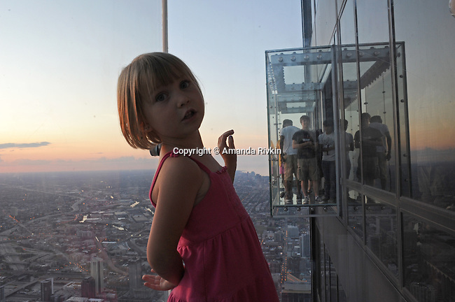 """Jori Boyer, 4, of La Crescent, Minnesota on the newly opened glass balconies """"The Ledge"""" at the Skydeck at the Sears Tower in Chicago, Illinois on July 6, 2009."""