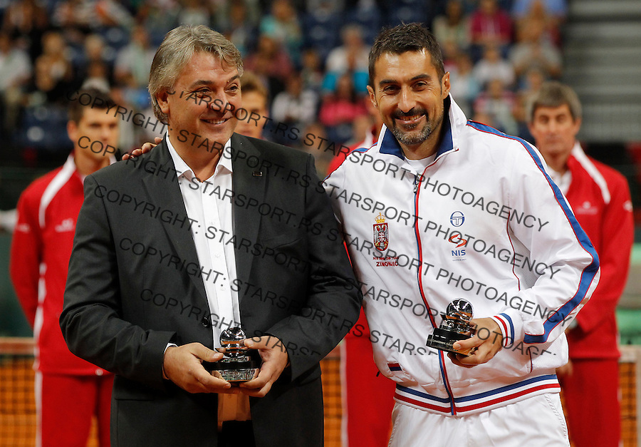 Tennis Tenis<br /> Davis Cup semifinal polufinale<br /> Serbia v Canada<br /> Award ceremony<br /> Slobodan Zivojinovic Nenad Zimonjic <br /> Beograd, 14.09.2013.<br /> foto: Srdjan Stevanovic/Starsportphoto &copy;