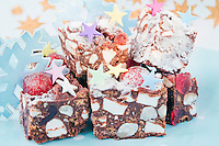 Chunks of 'Rocky Road' are decorated with Christmas stars and icing sugar