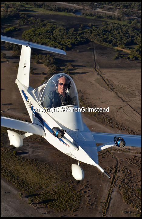 BNPS.co.uk (01202 558833)<br /> Pic: KarenGrimstead/BNPS<br /> <br /> My other planes a 747...!<br /> <br /> Former British Airways pilot Bob Grimstead(70) has swapped piloting a Jumbo jet for the worlds smallest twin jet aircraft.<br /> <br /> These remarkable photos capture the world's smallest twin-jet which resembles a 'bubble car on wings' taking to the skies.<br /> <br /> British pilot Bob Grimstead, 70, reached speeds of up to 140mph and climbed to 5,000ft in the Colomban Jet Cri-Cri.<br /> <br /> His wife Karen, 62, was in an aircraft next to him to take these snaps as he indulged in some aerial acrobatics, including several loops and rolls and a dramatic dive.<br /> <br /> The jet, which is almost entirely made of aluminium, is just 13ft long, 4ft wide and has a wingspan of 17ft, while weighing in at a paltry 180lb.<br /> <br /> Mr Grimstead, who lives in Sussex, has flown aircraft for 50 years and worked as a commercial pilot. He flew enormous Boeing 747s, which are at the complete opposite end of the size spectrum, weighing 400 tonnes when full of passengers and measuring 230ft in length, with a 210ft wingspan and a cabin width of 20ft.