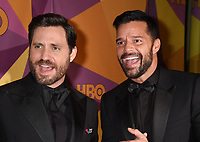 BEVERLY HILLS, CA - JANUARY 07: Actor Edgar Ramirez (L) and singer/actor Ricky Martin arrive at HBO's Official Golden Globe Awards After Party at Circa 55 Restaurant in the Beverly Hilton Hotel on January 7, 2018 in Los Angeles, California.