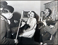 BNPS.co.uk (01202 558833)<br /> Pic: Marlows/BNPS<br /> <br /> New bride Gretl Braun being serenaded by Nazi musicians.<br /> <br /> Taken just three days before D-Day this remarkable photo shows Adolf Hitler celebrating the wedding of his brother-in-law - who he had executed a year later.<br /> <br /> The previously unseen image shows the Nazi dictator congratulating Hermann Fegelein and bride Gretl Braun, little realising that the course of the Second World War was about to turn against him.<br /> <br /> It was found in a gallery of 12 snaps of the wedding reception that lasted for thee days and was organised by Eva Braun, the elder sister of Gretl and Hitler's mistress.<br /> <br /> The fuhrer was one of the witnesses to the marriage along with SS chief Heinrich Himmler and Martin Bormann, Hitler's private secretary.<br /> <br /> The 12 black and white photos taken at her first wedding have sold at Marlows auctioneers of Stafford for &pound;400.