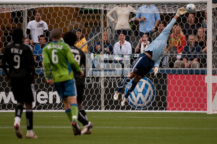 Osvaldo Alonso (6) of the Seattle Sounders scores over Josh Wicks (r) of DC United in the match played on June 17, 2009 at Quest Field in Seattle, WA. The Sounders and United played to a 3-3 draw.