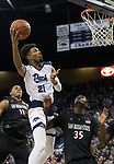 Nevada forward Jordan Brown (21) lays the ball up over San Diego State forward Joel Mensah (35) and forward Matt Mitchell (11) in the second half of an NCAA college basketball game in Reno, Nev., Saturday, Mar. 9, 2019. (AP Photo/Tom R. Smedes)