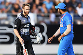 8th February 2019, Eden Park, Auckland, New Zealand;  Kane Williamson and India's Rohit Sharma discuss the wicket of Mitchell.<br />