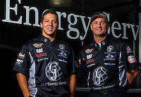 Sept. 1, 2014; Clermont, IN, USA; NHRA top fuel dragster driver Bob Vandergriff Jr (right) and Dave Connolly pose for a portrait in the pits during the US Nationals at Lucas Oil Raceway. Mandatory Credit: Mark J. Rebilas-USA TODAY Sports