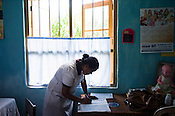 A nurse keeps the records at a health clinic in Eskdale Tea Estate in Nuwareliya in Central Sri Lanka.  Photo: Sanjit Das/Panos