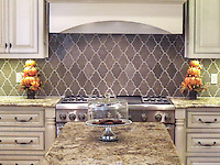 This custom mosaic backsplash features Djinn, a handmade mosaic shown in honed Montevideo, a part of the Silk Road Collection by Sara Baldwin for New Ravenna.<br />