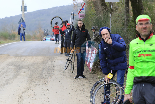 Team helpers wait for the peloton on gravel sector 3 Radi during the 2017 Strade Bianche running 175km from Siena to Siena, Tuscany, Italy 4th March 2017.<br /> Picture: Eoin Clarke | Newsfile<br /> <br /> <br /> All photos usage must carry mandatory copyright credit (&copy; Newsfile | Eoin Clarke)