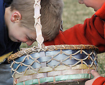 Ben Albert, 5, left, sticks his head in a basket looking at all the plastic eggs collected by Jacob Lichtman, 7, both of South Windsor Conn., during the annual Easter egg hunt at South Windsor High School, Friday, April 6, 2012. (AP Photo/Journal Inquirer, Jim Michaud)