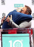 HOLLYWOOD, CA - APRIL 12: Rob Reiner, Billy Crystal, at 2019 10th Annual TCM Classic Film Festival - Hand and Footprint Ceremony: Billy Crystal at the TCL Chinese Theatre IMAX on April 12, 2019. <br /> CAP/MPI/FS<br /> ©FS/MPI/Capital Pictures