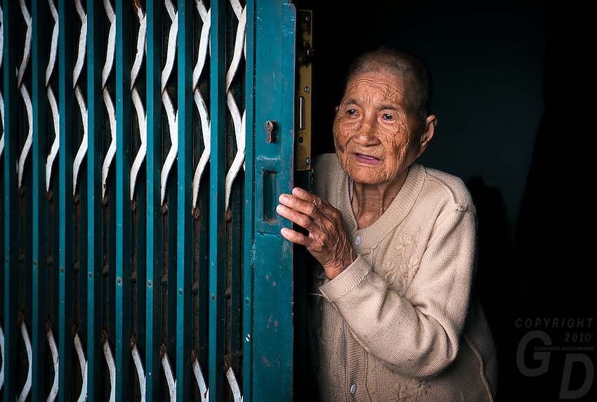 "This beautiful old lady just open the gate for me. Near Can Tho, the hub of the Mekong Delta (Vietnamese: Đồng bằng Sông Cửu Long ""Nine Dragon river delta""), also known as the Western Region (Vietnamese: Miền Tây or the South-western region (Vietnamese: Tây Nam Bộ) is the region in southwestern Vietnam where the Mekong River approaches and empties into the sea through a network of distributaries. The Mekong delta region encompasses a large portion of southwestern Vietnam of 39,000 square kilometres (15,000 sq mi). The size of the area covered by water depends on the season.<br />