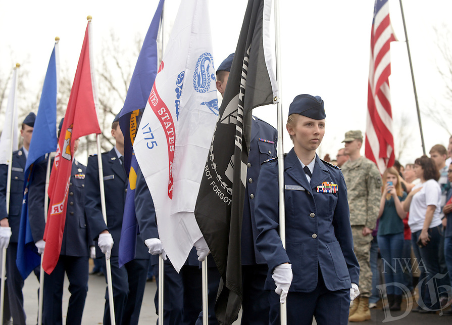 NWA Democrat-Gazette/BEN GOFF @NWABENGOFF<br /> Chief Master Sgt. Holly Holmes-Smith of Pea Ridge with the 115th Composite Squadron of the Civil Air Patrol leads the squadron's flag detail in the opening procession on Saturday Dec. 12, 2015 during the Wreaths Across America ceremony at Fayetteville National Cemetery. Family members and volunteers with various veterans and community groups helped place a balsam remembrance wreath on the grave of each veteran at the cemetery as part of National Wreaths Across America Day.