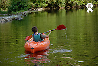Boy (12-13) kayaking in river, rear view (Licence this image exclusively with Getty: http://www.gettyimages.com/detail/73013988 )