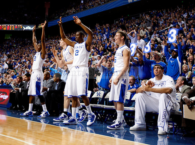 Teammates throw up three symbols after Terrence Jones makes a three in the second half of UK's win over the Penn Quakers at Rupp Arena on Jan. 3, 2011. Photo by Britney McIntosh | Staff