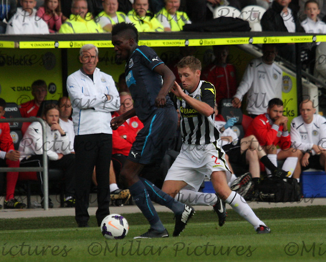 Sammy Ameobi being pressured by David van Zanten in the St Mirren v Newcastle United friendly match played at St Mirren Park, Paisley on 30.7.13.