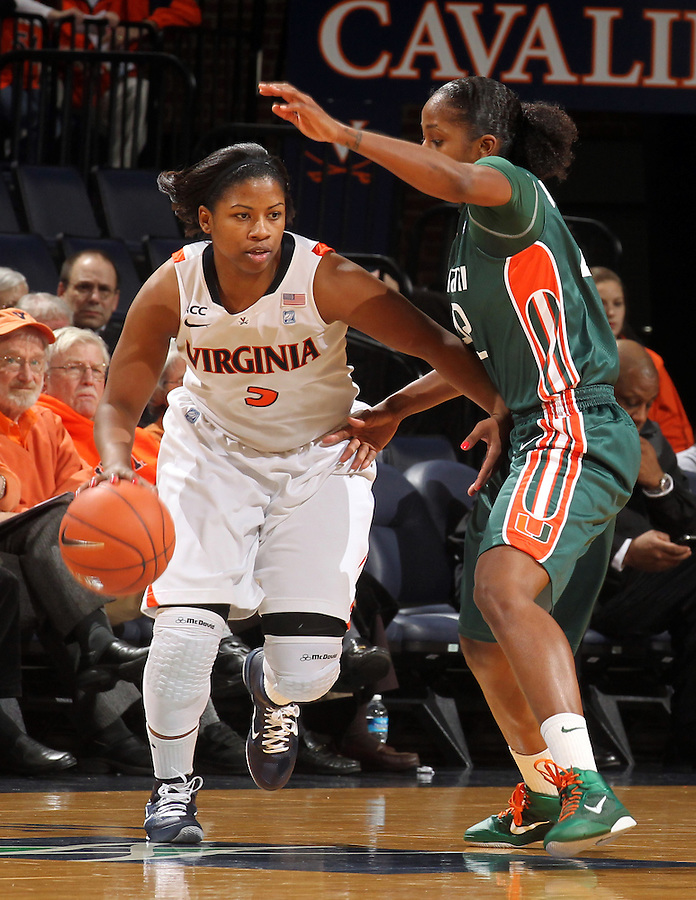 Jan. 6, 2011; Charlottesville, VA, USA; Virginia Cavaliers guard Paulisha Kellum (3) drives past Miami Hurricanes guard Shenise Johnson (42) during the game at the John Paul Jones Arena.  Mandatory Credit: Andrew Shurtleff-