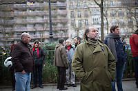 People gather near the site of the massacre at Charlie Hebdo in Paris where masked gunmen killed 12 people. Paris, France, (Jan. 7, 2015).