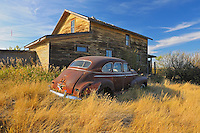Old car and house in ghost town<br /> Laverna<br /> Saskatchewan<br /> Canada