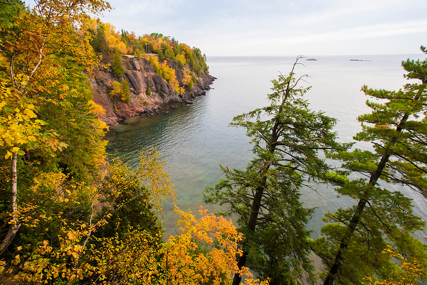 Fall foliage and cliffs over Lake Superior at Presque Isle Park, Marquette, Michigan.