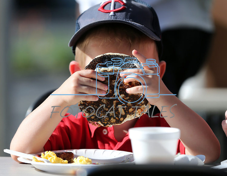 Everett hogan, 3, plays peek-a-boo with his pancakes at the Summer Reading Program Pancake Breakfast Kick-Off at the Carson City Library, in Carson City, Nev., on Saturday, June 8, 2013. <br /> Photo by Cathleen Allison