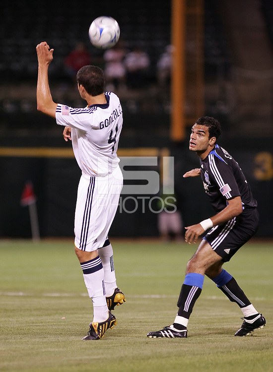Omar Gonzales (4) heads the ball over Pablo Campos (9). San Jose Earthquakes tied Los Angeles Galaxy 1-1 at the McAfee Colisum in Oakland, California on April 18, 2009.
